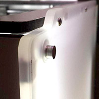 Axes qui sortentLes axes de l'imprimante sortent de quelques millimètres sur le côté.